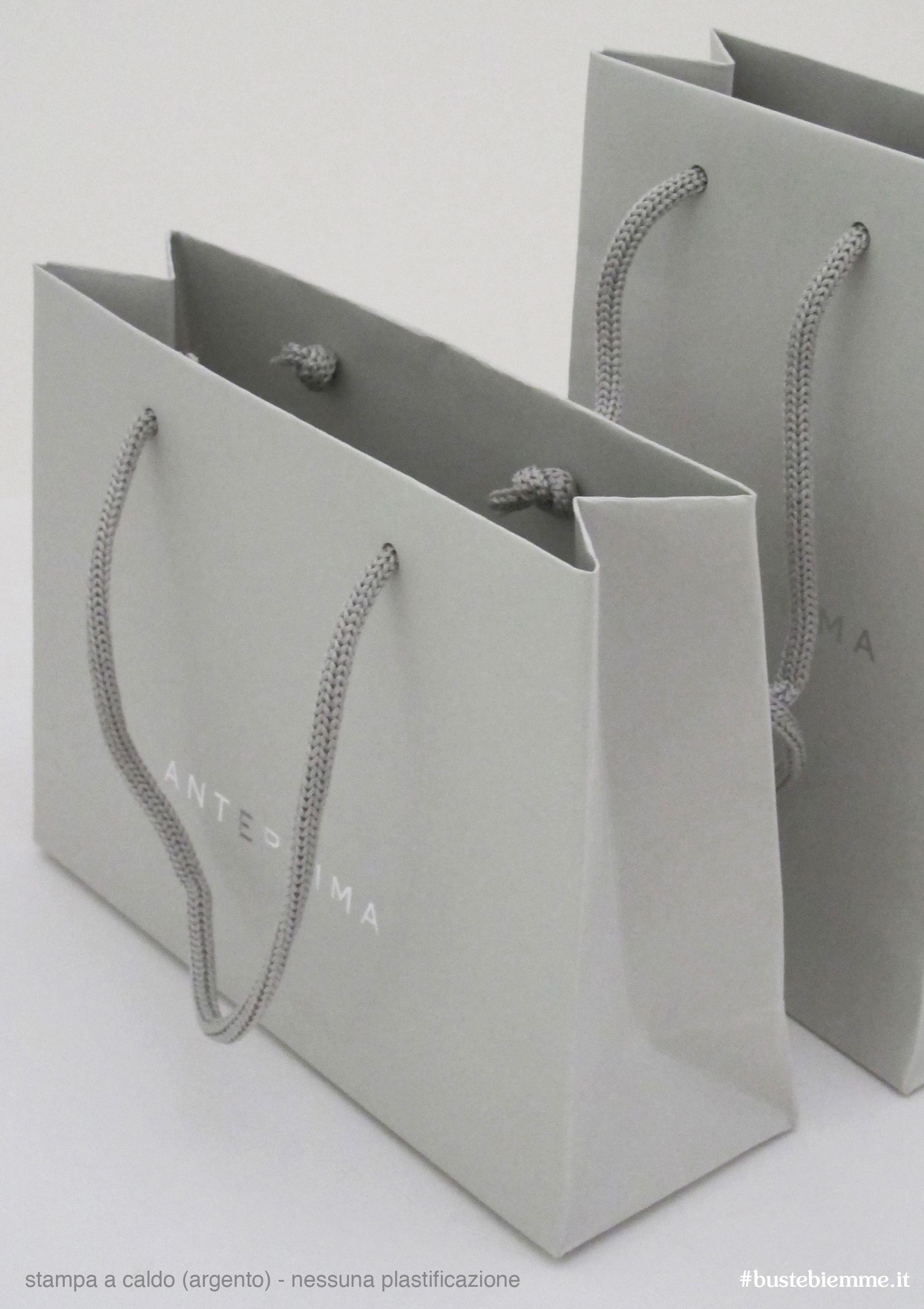 shopper in carta manici in tessuto stampa a caldo argento e nessuna plastificazione