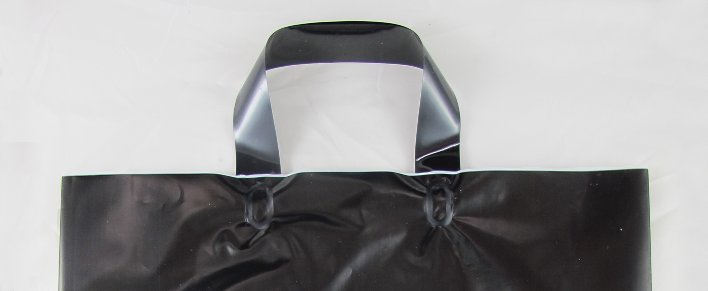 sacchetto in plastica personalizzato con maniglia fettuccia termosaldata